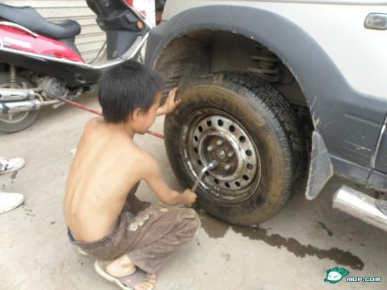 A 10-year-old Chinese boy is a skilled car mechanic.
