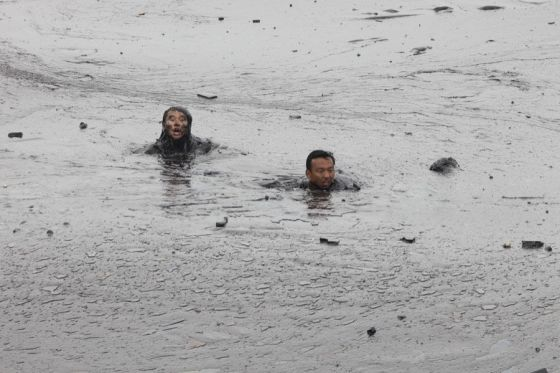 Chinese firefighter drowns before the camera in the 2010 Dalian oil spill.
