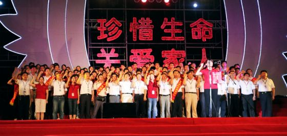 Foxconn workers at a rally pledging to cherish life.