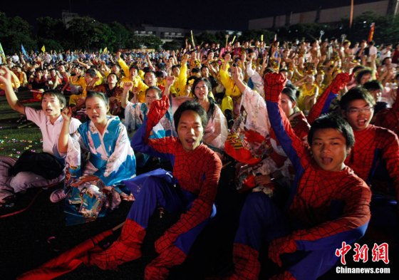 Foxconn workers in Spiderman costumes at a Foxconn rally where employees pledge to love their lives and their families.