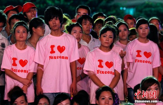 "Foxconn employees wearing ""I love Foxconn"" pink t-shirts."