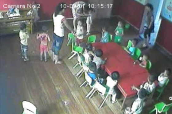 China, a teacher and mother of a fellow classmate repeatedly hits a 2-year-old girl.