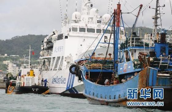Chinese fishing boat docked with Japanese coast guard in Okinawa.