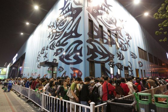 A line of World Expo visitors waiting to enter a pavilion.