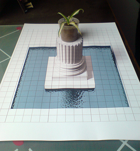3D chalk art: A column in a pool of water.