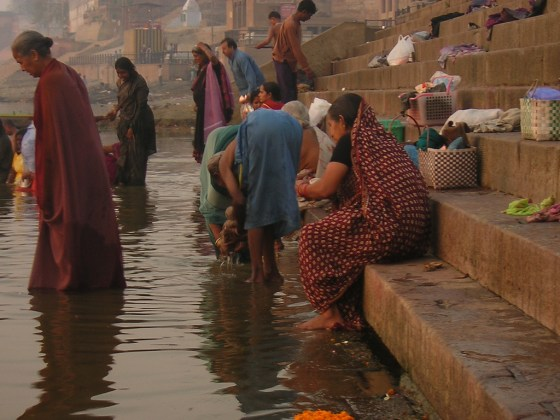 Indian women bathing by the Ganges River.