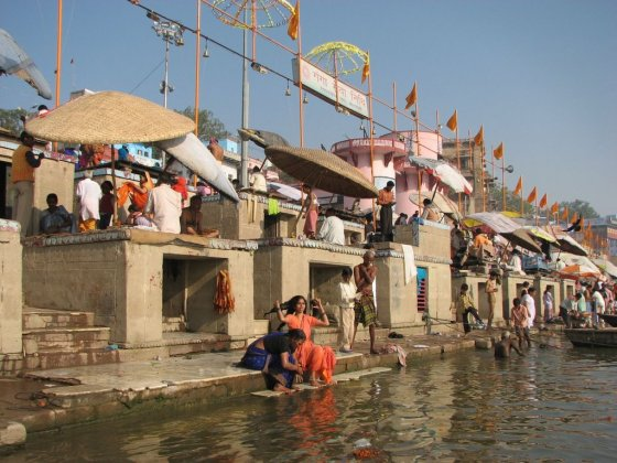 Young Indian women bathing by the Ganges River.