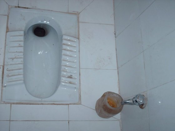 A squatting toilet in India.