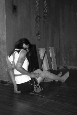 A Chinese woman tied up in an underground bondage and domination sadism masichism dungeon in Nanjing, China.