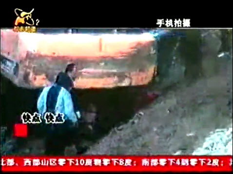 Zhumadian woman crushed under construction vehicle while trying to stop the construction.