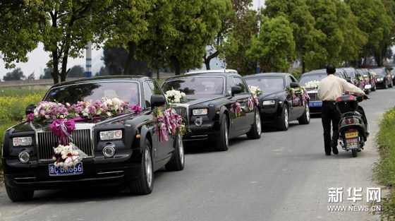 Rolls Royce Phantoms part of a wedding motorcade for a young couple in Wenzhou, China.