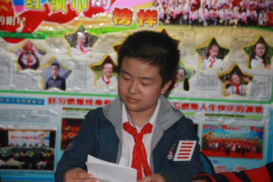 "12-year-old Huang Yibo is a ""five stripe"" Young Pioneer of China."