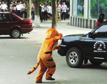 During a training exercise at the Chengdu Zoo in China, a man wearing a Tigger costume pretends to be an escaped tiger.