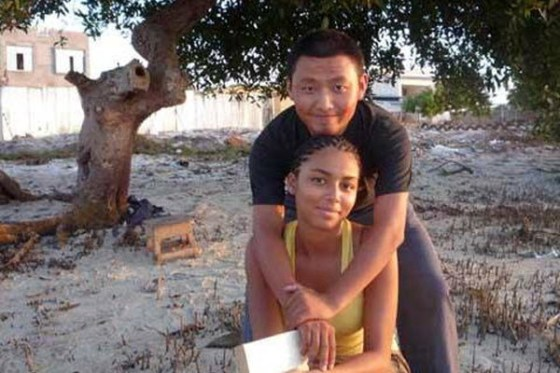 A Chinese male and African female couple.