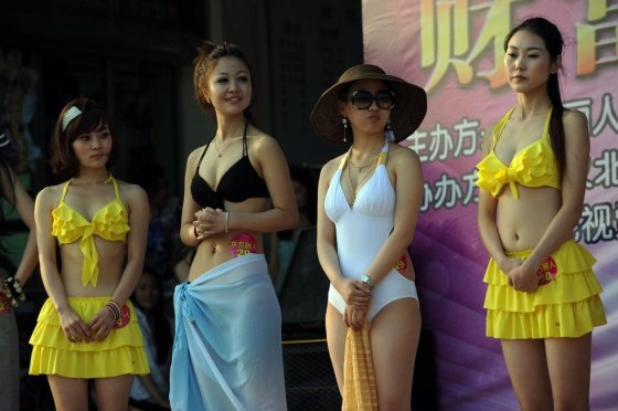 Chinese girls on stage at a matchmaking event for rich Chinese men in Wuhan, China.