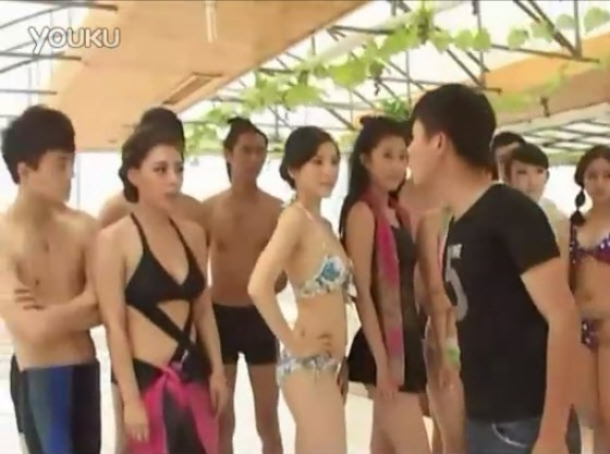 An angry boyfriend confronts his girlfriend at a bikini contest.