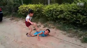 The little Chinese girl stomping on her cousin's back.