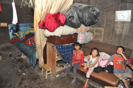 Migrant worker children living around a garbage dump in Guiyang, China.