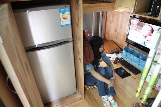 A mobile home made from a transformed delivery truck, complete with a flat screen television and refrigerator.