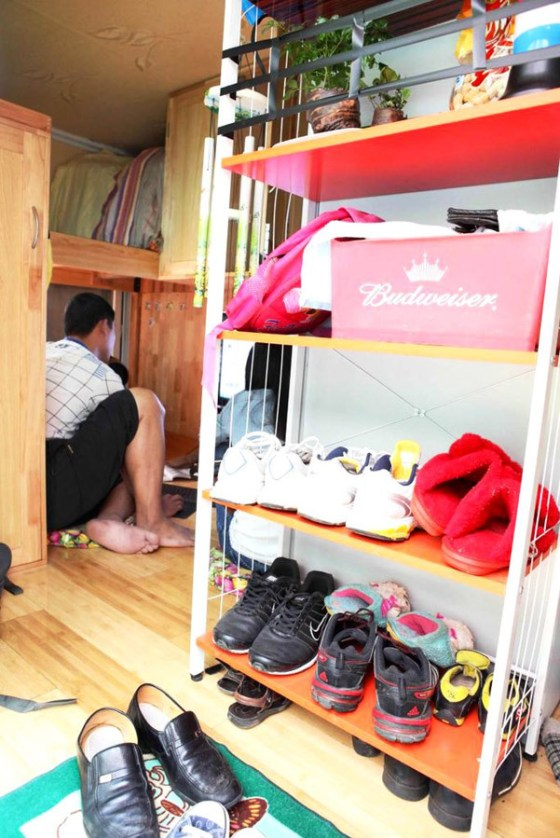 A shoe rack inside a cargo truck in Kunming, China that has been transformed into a mobile home for two.