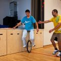 Inmates are trying to use a one-wheeled bicycle inside the prison gym during the time they regularly spend carrying out physical exercise and learning about the human body at the luxurious Halden Fengsel, (prison) near Oslo.