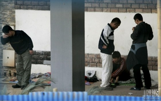 Chinese drug addicts gathered under an overpass in Shenzhen.