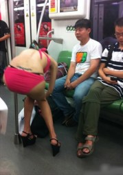 A beautiful Chinese girl in her underwear in front of male Shanghai Metro passengers.