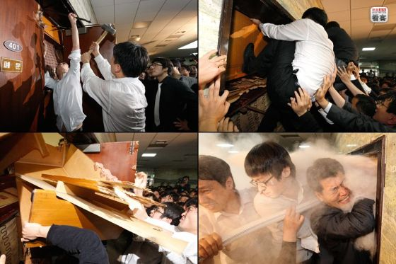Korean opposition party members attempt to break into a meeting by the ruling party discussing allowing American beef imports.