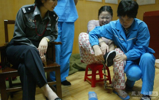 Condemned Chinese female prisoner He Xiuling tries on her new shoes on the night before her execution.