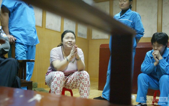 Condemned Chinese female prisoner He Xiuling cries while singing on her last night.