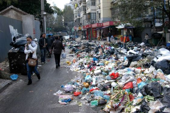 Garbage dumped on the streets of Nanjing following a strike by city sanitation workers.