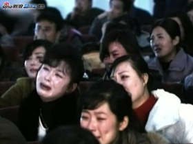 Shown on North Korean news, a crowd of crying North Koreans after learning of Kim Jong Il's death.