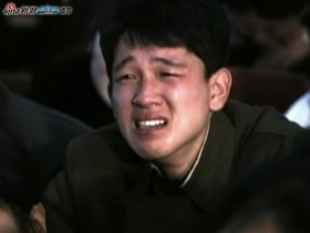 A North Korean young man weeps with news of leader Kim Jong-il's death.