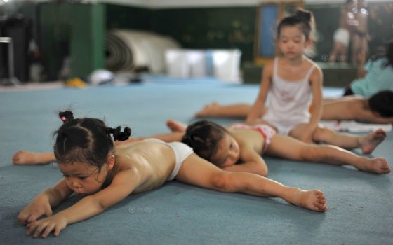 Little Chinese children undergoing gymnastics training.