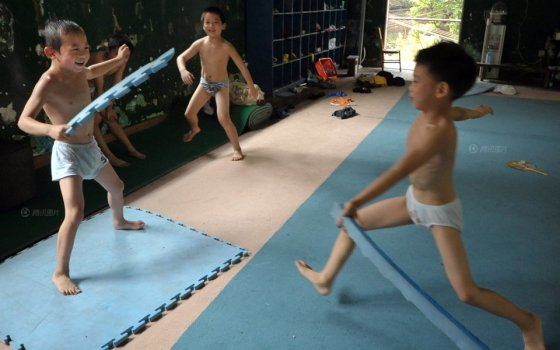 Several Chinese children playing around after gymnastics training.
