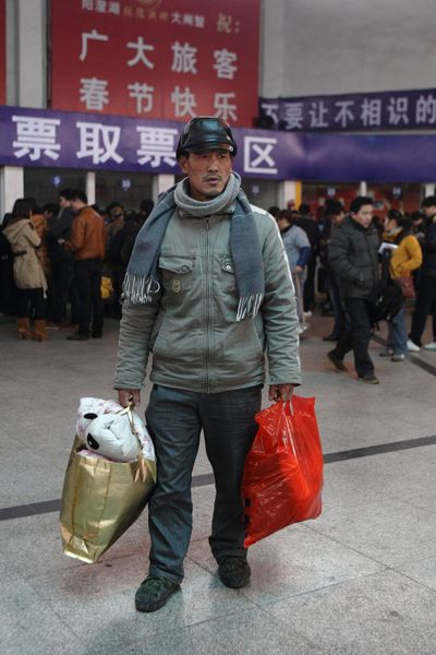 Li Zhuqing, a Chinese migrant worker, at a train ticketing office in Zhejiang province trying to buy a ticket home for the holidays.