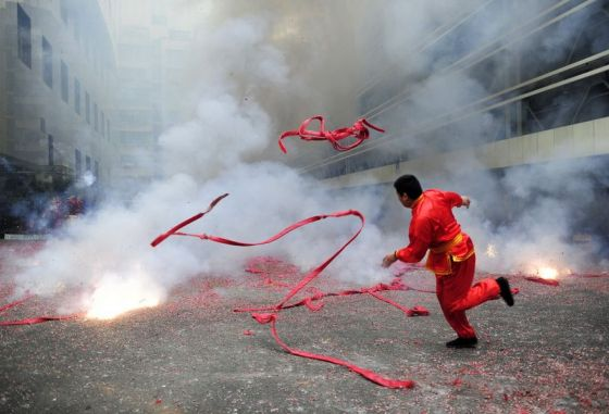 Chinese business owners light firecrackers to ring in the first day of opening for business in the new year, hoping it will bring them good luck.