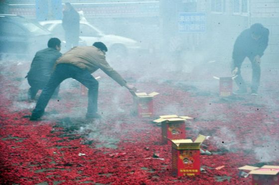 Chinese business and store owners setting off fireworks and firecrackers on the 7th day of the Chinese New Year.