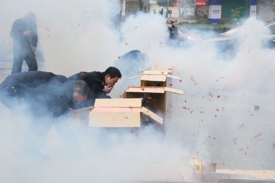 Chinese people setting off fireworks for good fortune on the 7th day of the Lunar New Year.