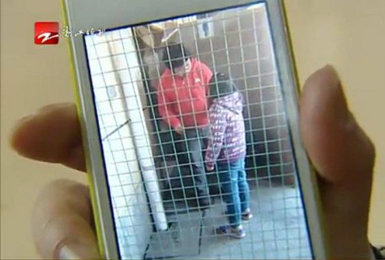 An iPhone photo of a Chinese man who punished his 10-year-old daughter by forcing her to eat excrement from a public restroom.