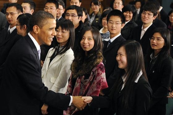 American President Barack Obama shakes hands with Chinese students in Shanghai.