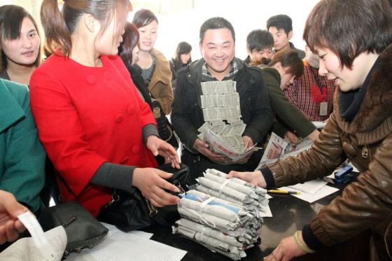 A public bus company in Henan province of China pays its employee wages with the loose cash and coins collected as fare.