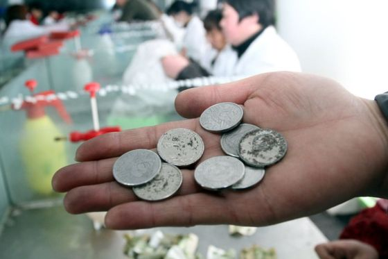 Game tokens that some bus riders have deposited as fare in Shangqiu city of Henan province in China.