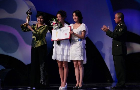 Armless Chinese girl Lei Qingyao, star of the Invisible Wings movie, at China's 2008 Golden Rooster Awards in Dalian.