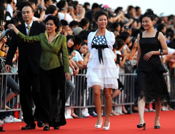 Armless Chinese girl Lei Qingyao, star of the Invisible Wings movie, on the red carpet at China's 2008 Golden Rooster Awards in Dalian.