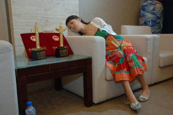 Armless Chinese girl Lei Qingyao, star of the Invisible Wings movie, resting.