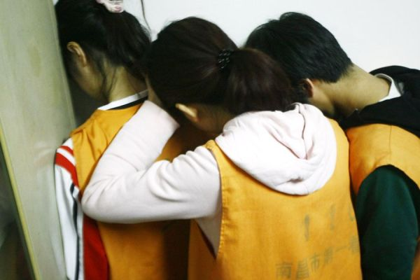 A gang of Chinese youth who used underage girls pretending to be virgins to prostitute themselves to men who would then be extorted.