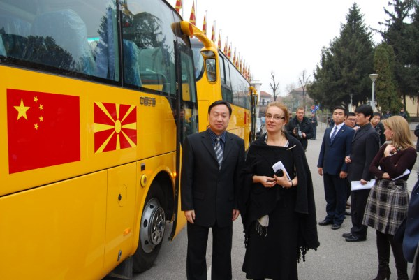 Chinese ambassador Cui with Macedonian Deputy Prime Minister Arifi during the handover of 23 Chinese-made school buses to Macedonia.