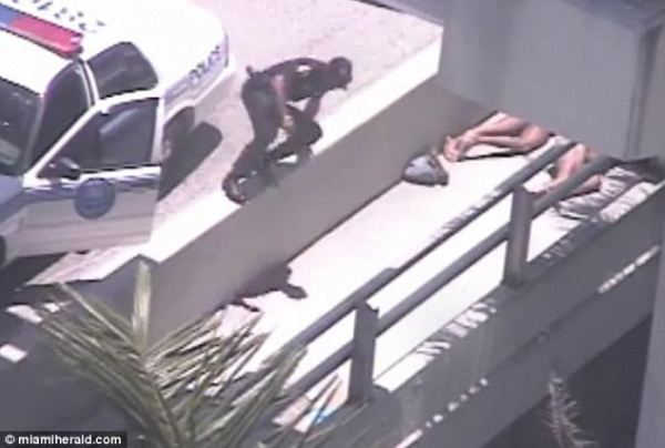 Two naked men lying on the sidewalk of the MacArthur Causeway in Miami South Beach in a case of cannibalism.