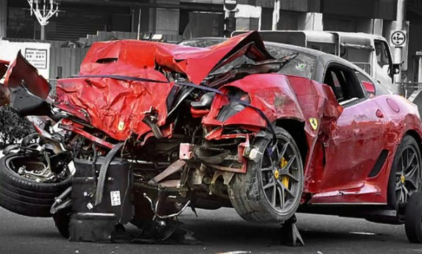 Crashed red Ferrari owned by a mainland Chinese man in Singapore.